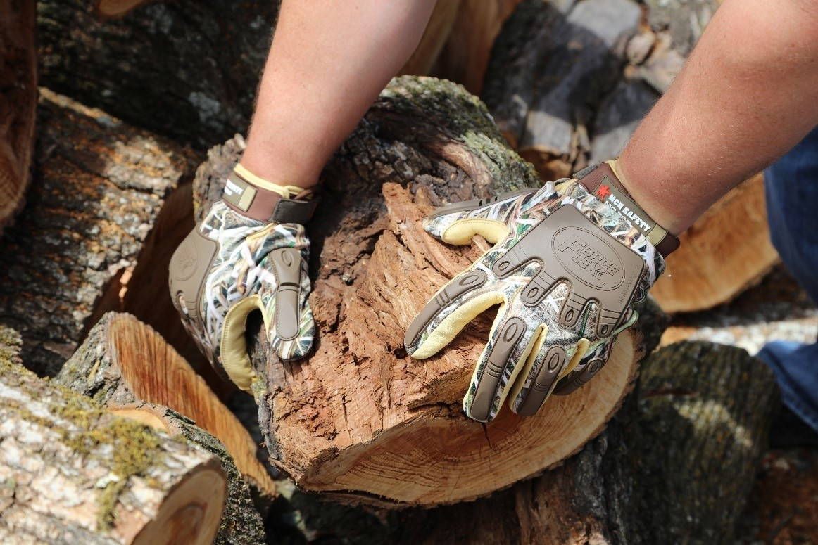 Camo Gloves holding wood