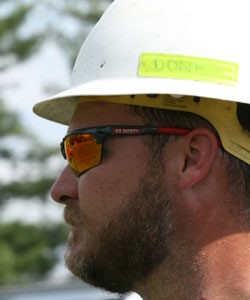 MCR Safety worker with glasses and hard hat