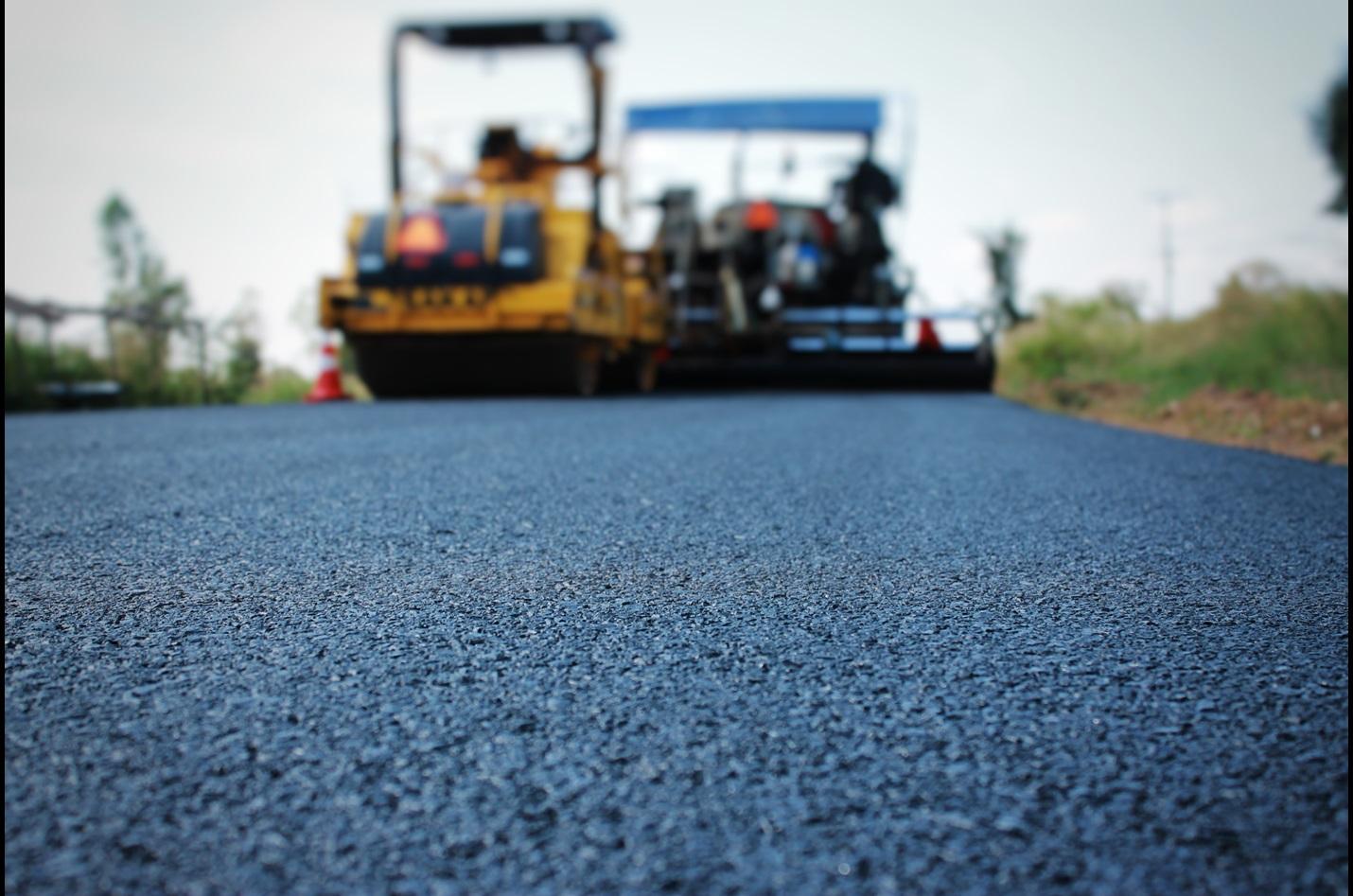Resurfacing asphalt-based construction