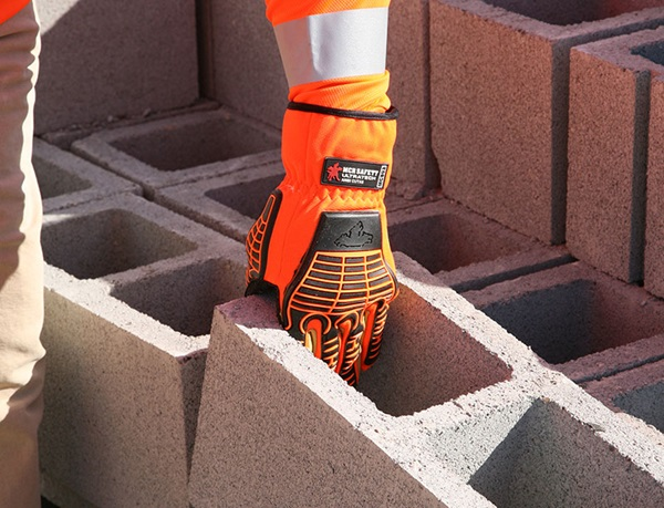 MCR Safety Hi-Vis Glove Picking up Concrete block